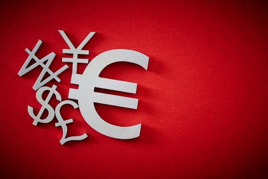 Currency symbols on red background