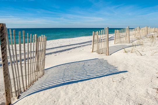 Empty white sand beach with fences,  Gulf of Mexico coast, Alabama, USA
