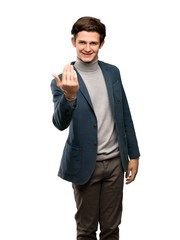 Teenager man with turtleneck inviting to come with hand. Happy that you came over isolated white background