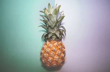 Pineapple on two color backgrounds, selective focus