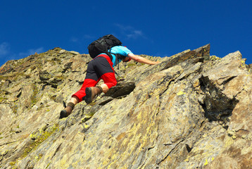 A climbing man on the rock