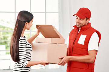 Good customer service costs less than bad customer service. Young woman receiving parcels from delivery man