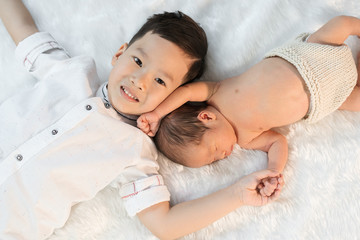Newborn baby boy and older brother