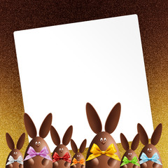 happy easter gift card, chocolate bunnies with ribbons bows, on shiny golden background