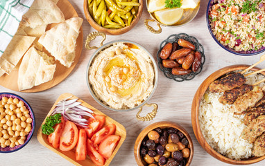 Iftar food table. Evening meal for Ramadan. Arabic cuisine. Middle Eastern traditional lunch. Assorted of Egyptian oriental dishes. Top view