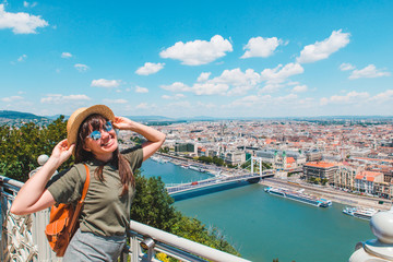 Fototapeten Budapest smiling cheerful woman in sunglasses. budapest city on background. travel concept. copy space