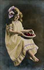 Little Girl in Yellow Dress with Basket of Fruit
