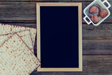 Passover recipe or greeting composition with chalkboard or blackboard and matzah or matza with copy space.