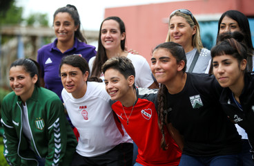 The captains of the principal Argentinian soccer teams pose for a picture after the presentation of the women's professional soccer league, in Buenos Aires