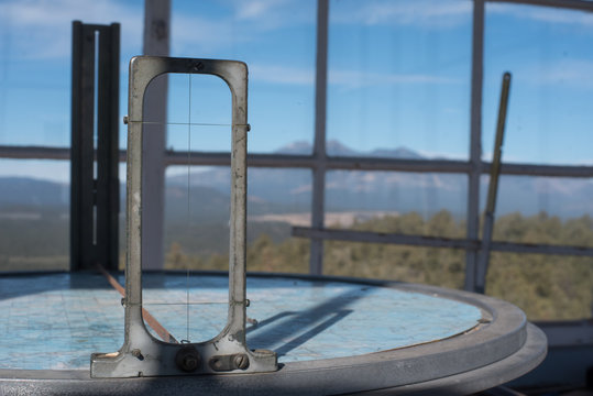 Osborne fire finder cross hairs in an Arizona watch tower with mountains