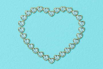 Heart-shaped frame made of small heart cut diamonds in yellow gold settings on turquoise textured background