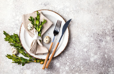 Easter table setting  on on gray background. Holiday decoration.Happy Easter concept. Copy space for Text.