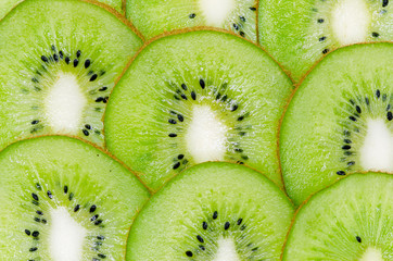 Sliced ripe kiwi closeup, exotic fruit texture