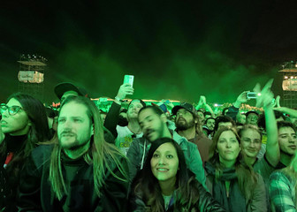 Fans watch the Red Hot Chili Peppers performs at Egypt's Giza pyramids, on the outskirts of Cairo