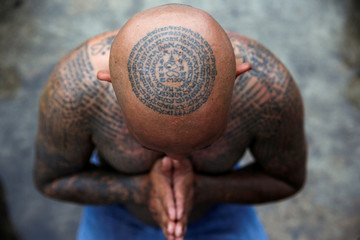 A devotee attends the religious tattoo festival at Wat Bang Phra Monastery, where devotees believe that their tattoos have mystical powers, in Nakhon Pathom province