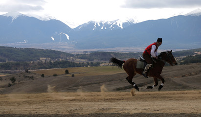 Man rides horse during celebrations marking the traditional holiday Todorovden in Bachevo