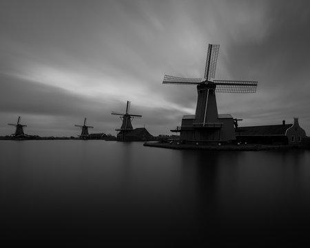 Long exposure capture of sunrise at the windmills of Zaanse Schans, Netherlands