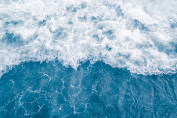 Pale blue sea wave during high summer tide, abstract ocean background Wall mural