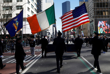 Marchers carry the New York State, Irish and America flags during the 258th St Patrick's Day Parade in New York