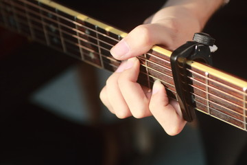 Man's hand playing acoustic guitar,Close up left hand