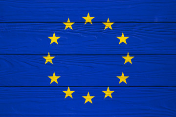 European Union flag on a wooden background
