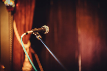 a lone mic at a stage