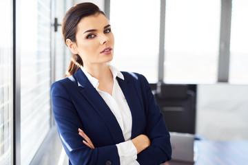Portrait of confident businesswoman standing in modern office