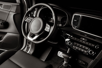 New car steering wheel, luxurious details in black leather
