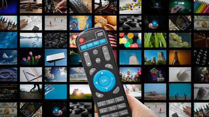 TV with pictures of smart television and man's hands with remote control