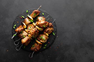 Grilled meat skewers, shish kebab on black background, top view Wall mural