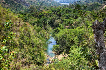 The view of river and Waterfall El- Nicho and trees and mountains in Cuba