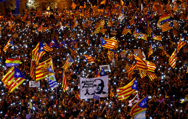 People take part in a rally of Catalan separatist organisations in Madrid