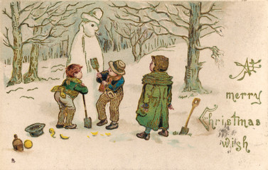 Boys Building a Snowman in the Woods