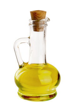 A glass bottle with olive oil isolated on a white background