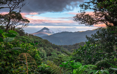 Photo sur Plexiglas Jungle Volcan Arenal dominates the landscape during sunset, as seen from the Monteverde area, Costa Rica.
