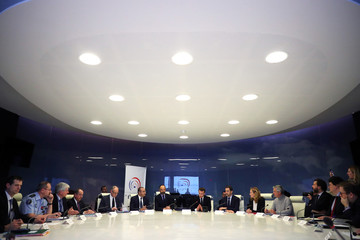 French President Emmanuel Macron (C) presides over an emergency crisis meeting at the Interior Ministry in Paris