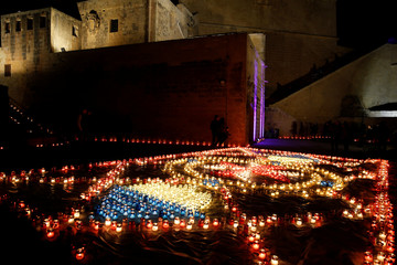 Visitors look at a display of candles during the Festival of Lights Cittadella, in the medieval citadel in Victoria, on the island of Gozo