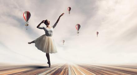 Elegant ballerina dancing. Mixed media