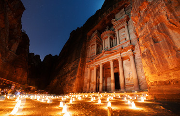 Petra by night, ancient architecture in canyon, Petra in Jordan. The rose city at night, famous travel destination in Middle-East, Jordan