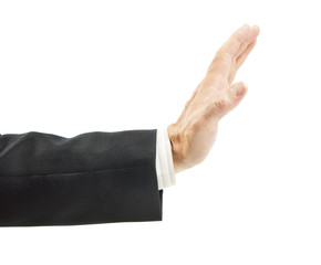 Man in a suit reaches his hand out with open palm for warning gesture isolated on white background