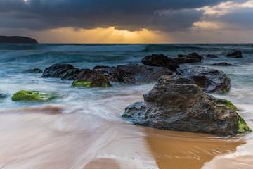 Rocky Sunrise Seascape with Sun Rays