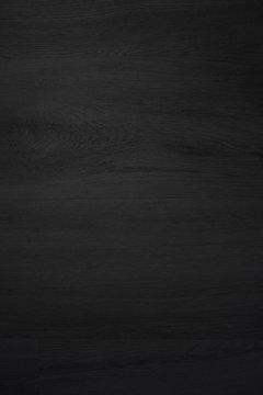 Black wood texture abstract background.