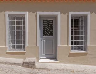 a humble house facade, Athens Greece, Anafiotika neighborhood