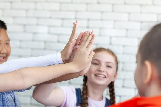 Kids hand assemble as a connection meeting teamwork concept. Teamwork conceptual.