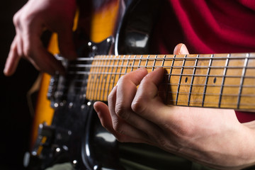 Guitar, string, guitarist, musician rock. Musical instrument. Electric guitar, rock concert. Guitarist play, musical equipment. Instrument on stage and band. Live music. Guitars and strings, performer