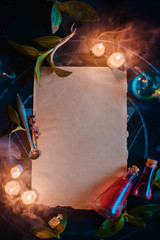 Blank parchment with candles and potions. Magical scroll template for ad or certificate. Dark still life with copy space