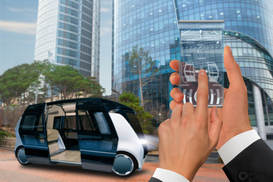 Control of autonomous taxi by futuristic smartphone with mobile app . Concept.