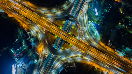 Staande foto Nacht snelweg Aerial view of the circle and expressway, motorway and highway in intersection