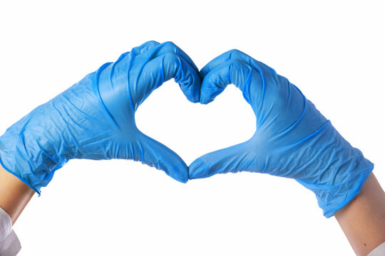 Close-up of hands in latex gloves. The heart is folded from the hands. Valentine card