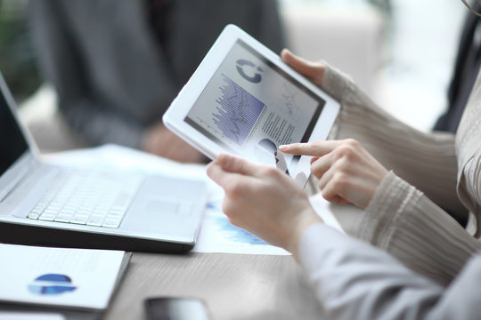 close up.the business team uses a digital tablet to verify financial data